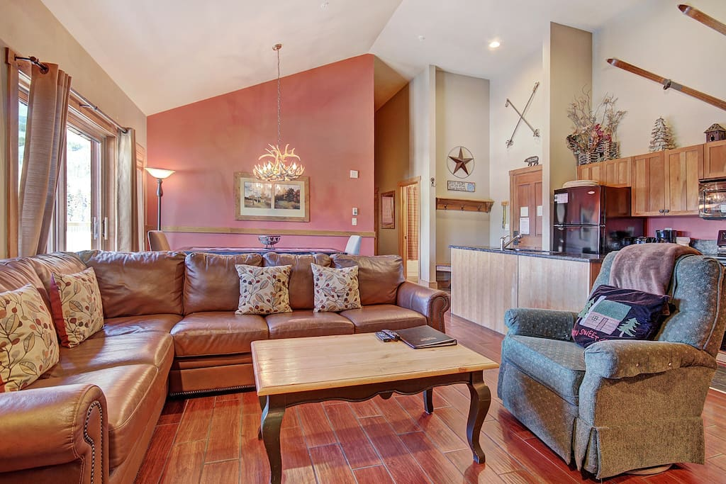 Living Room - Comfortable furnishings in front of the fireplace and flat-screen TV.
