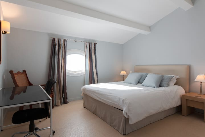 Spacious bedroom with large double bed, desk and study space. Silent air-conditioning and underfloor heating in the winter.