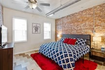 Make yourself comfy in the master bedroom complete with a brand new king cooling gel memory foam  mattress.  This brick was originally laid in 1900!  The entire home was recently remodeled in a modern rustic style.