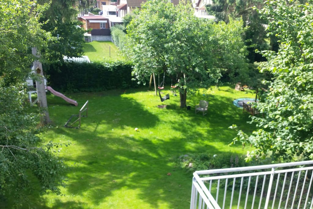 Our garden with swings, trampolin, soccergoals and a little playhouse with a slide. Kids love it:-)