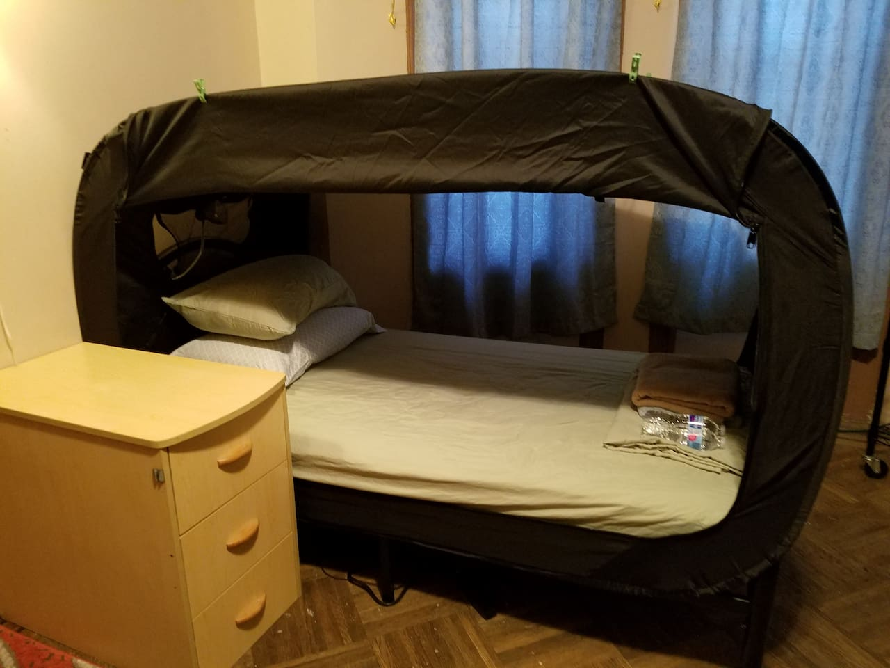 Single bed with huge privacy tent and inside reading light