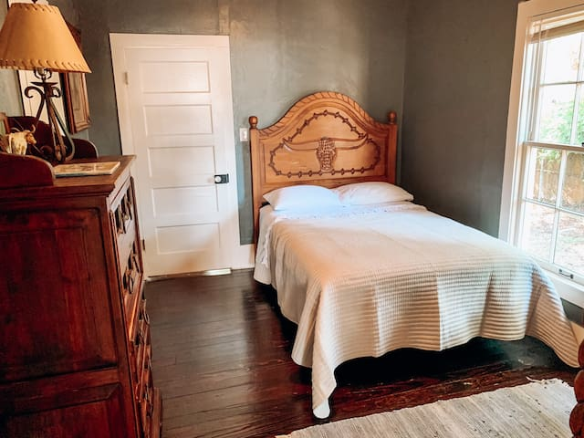 North Room - double bed, dresser, and armoire with some toys and games.