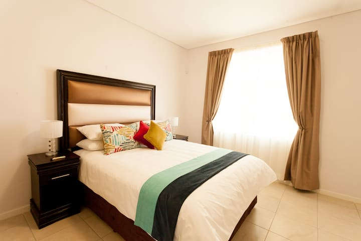 Apartments @ 125 - Unit 1; bedroom including queen size bed