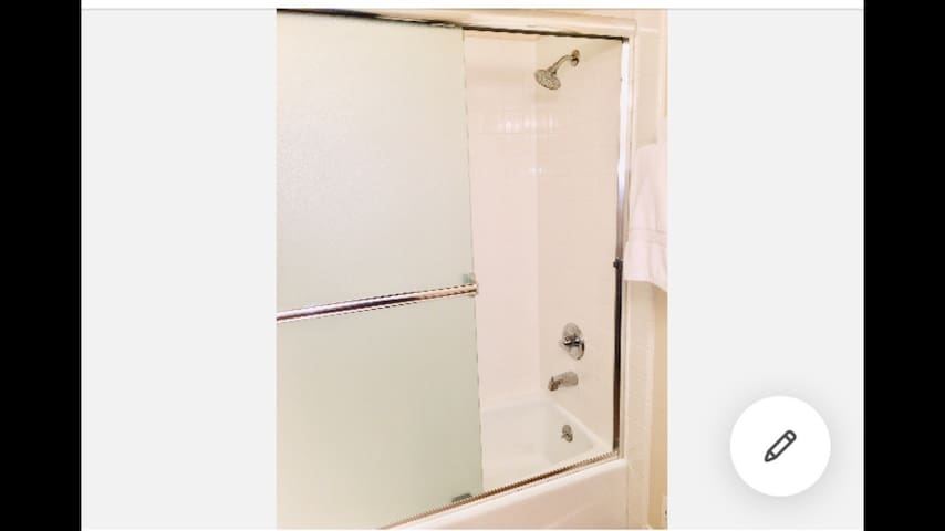 This is the bathroom for guests and has dove shampoo and conditioner. I provide large quantity towels and wash cloths  and hand towels ( please take your towel back to your room to dry)
