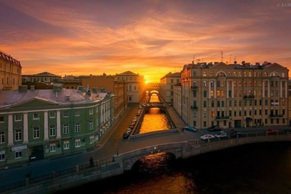 My apartment is in the right house, on the cross of two rivers, The building with the gallery is The Hermitage.
