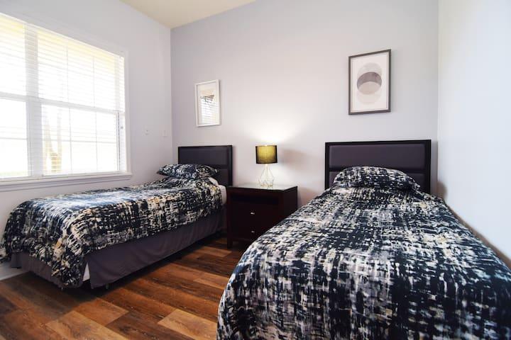 Bedroom 3 is a stylish twin bedroom