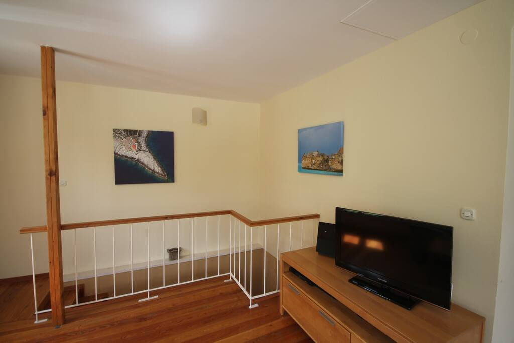 Living room with cable TV and stereo.