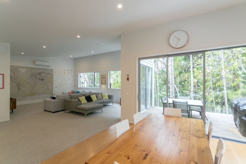 A calm space connected with the native bush through huge picture windows.