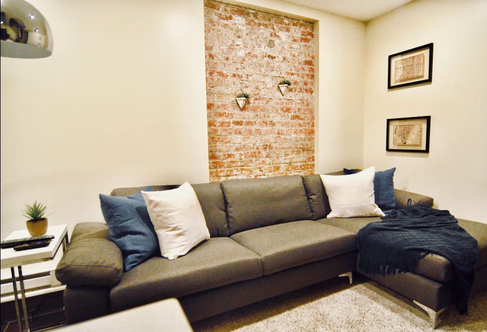 """You'll love lounging around after a long day in the city. The living room includes a 42"""" smart TV with cable and high speed internet."""
