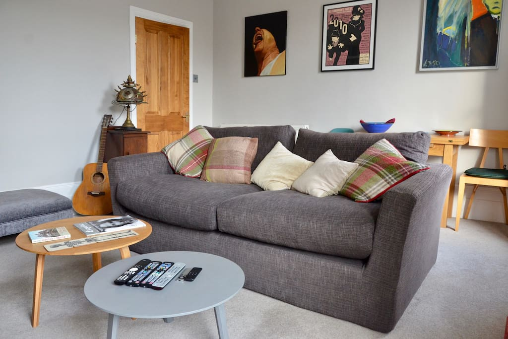 Comfortable sofa and fold out table for 4. Danish Hay coffee tables.