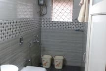 bathroom equipped with hot water geyser