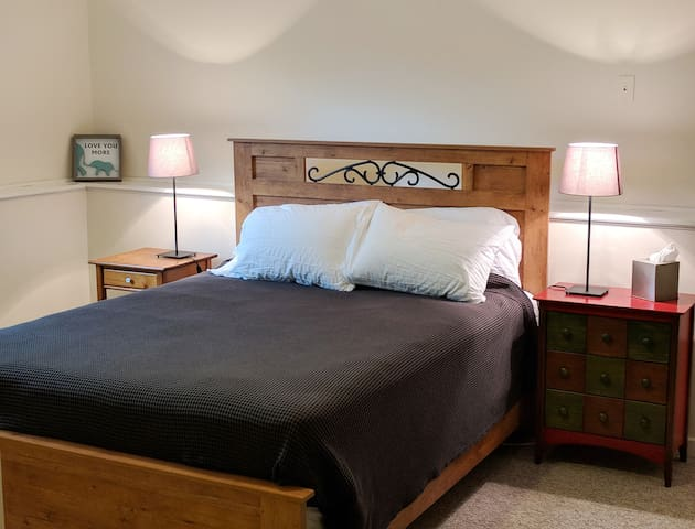 Queen bed in one of the bedrooms.