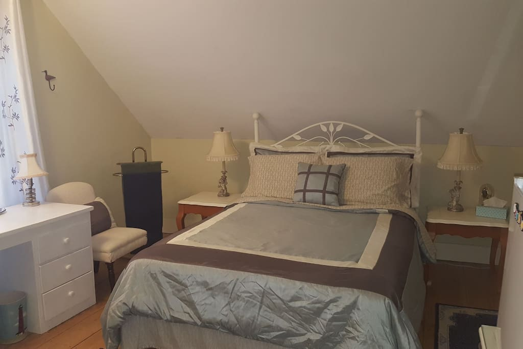 Sals Place bedroom 1. Comfortable double size bed. Room is furnished with a HD TV and refrigerator.