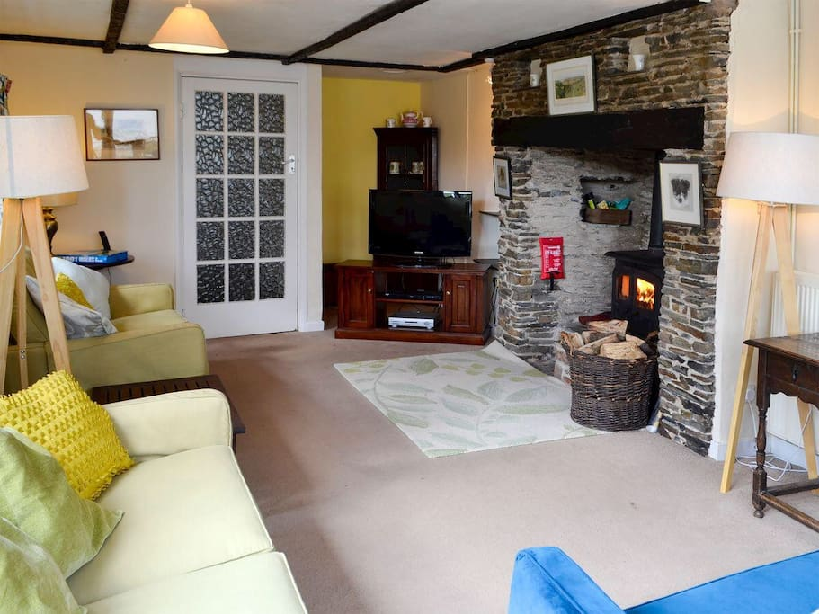 Large sitting room. Plenty of light and space! Double patio doors to outdoor eating area. Cosy wood burning stove in addition to the heating!
