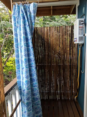 Private hot outdoor shower with views of the jungle.