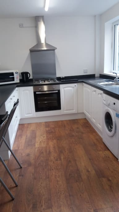 Fully fitted kitchen with washer and microwave