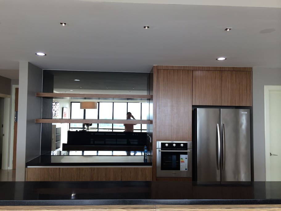 Functional dry kitchen with twin door fridge and oven