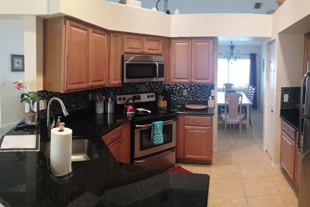 Beautifully renovated kitchen is fully stocked.