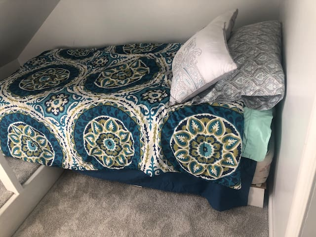 Upstairs private sleeping nook twin mattress perfect for child or adult.