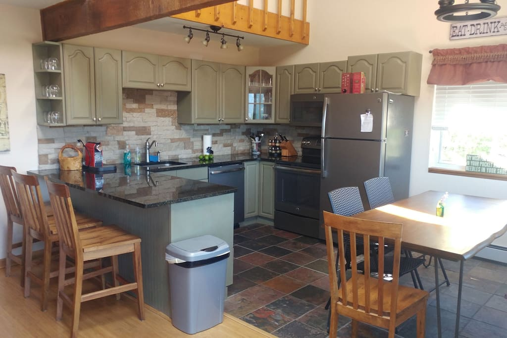 Spacious Kitchen with brand new appliances and granite counter top.