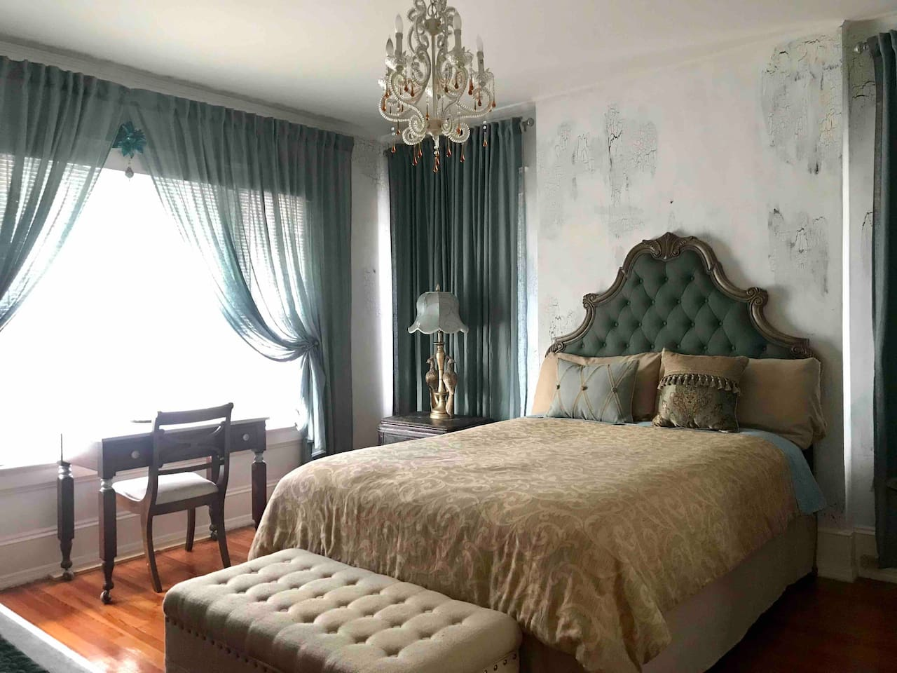 You'll feel like royalty while staying in the peacock inspired room. Sleeping on a comfy bed underneath an elegant chandelier will bring relaxation into your dreams.