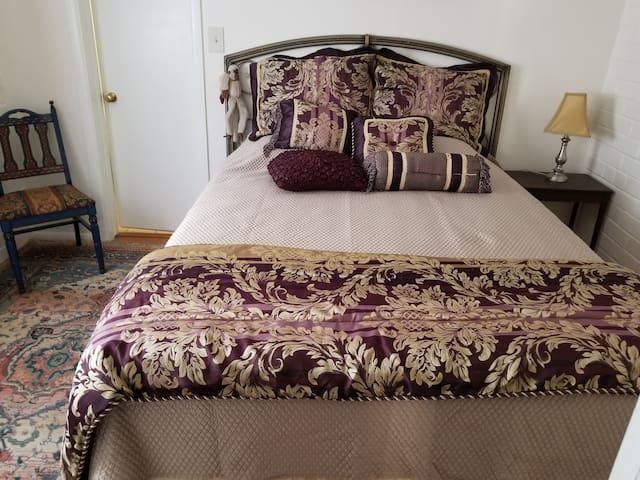 Comfortable queen size bed in bedroom.