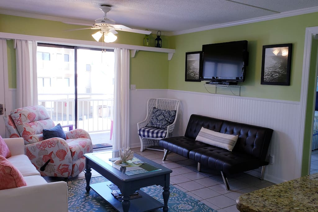 This coastal chic living room is perfect for relaxing after a great day on the beach.  Equipped with plenty of seating. This living room also includes a sleeper sofa as well as a futon for extra sleeping space.