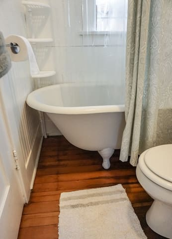 The apartment-sized clawfoot tub is original to the cottage.