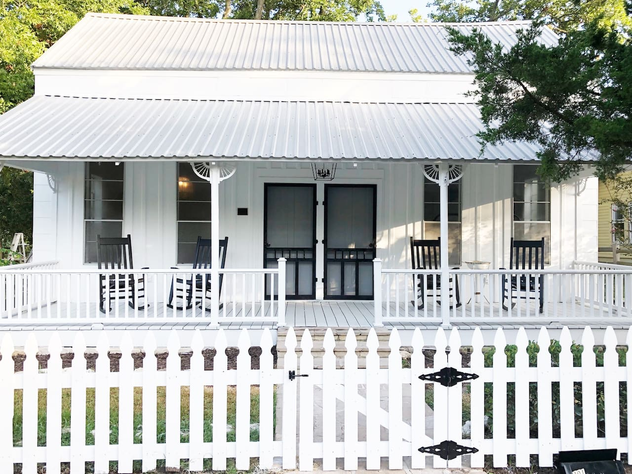 The Bloom Inn, fully remodeled 1895 farmhouse with large front porch & rocking chairs for relaxing.