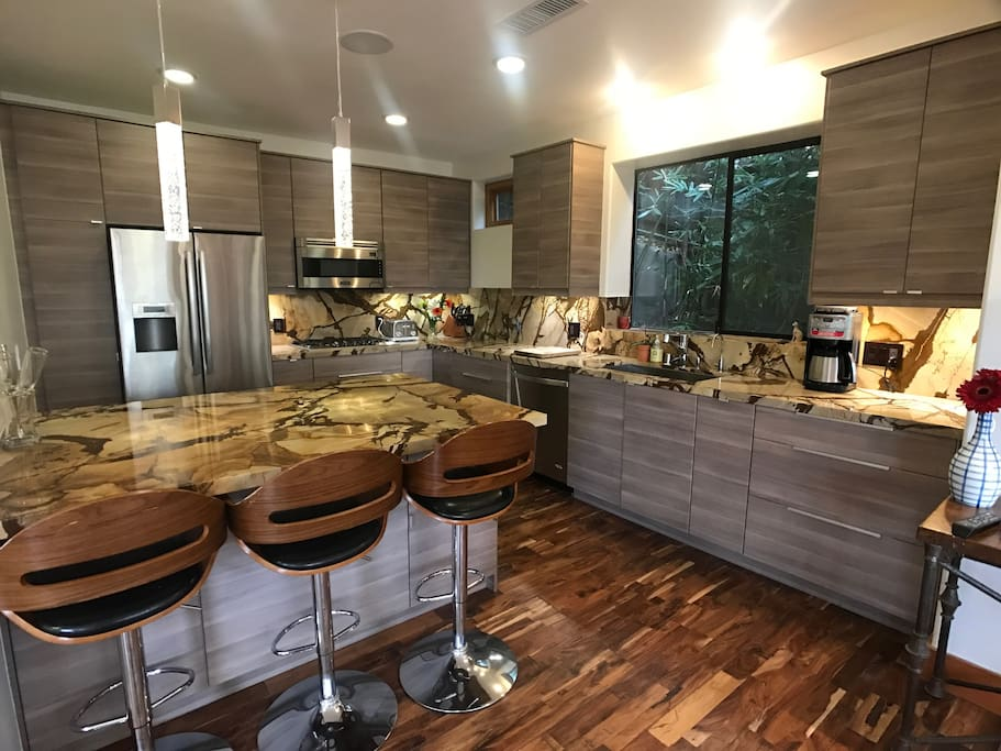 All Viking appliances  Instant hot water  Stone countertops with Island