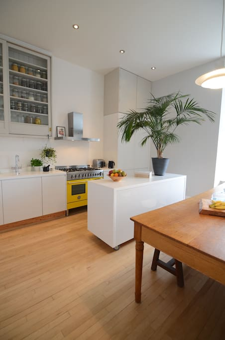 Kitchen with island unit on wheels for flexibility.