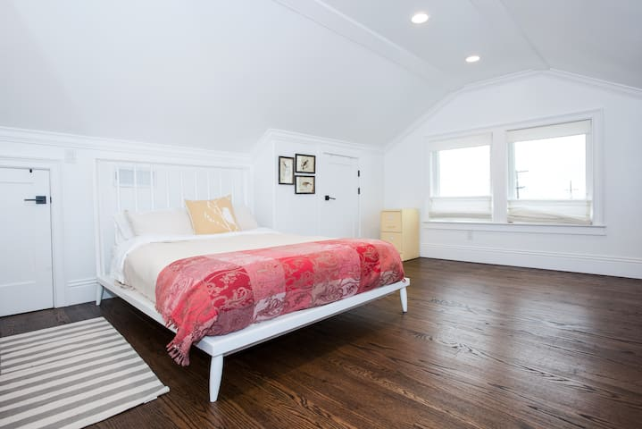Upstairs queen bedroom has a mid-century farmhouse flare and ocean views!