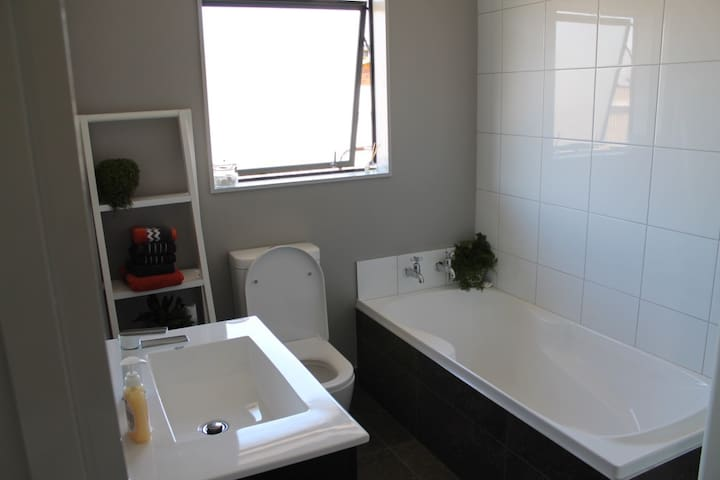 Bathroom with bath, toilet and shower