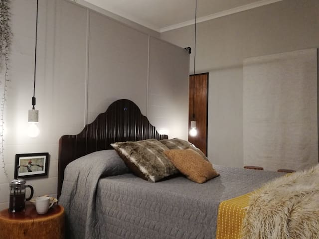 The open plan design is furnished with a standard double bed. We only use crispy white linen and towels.