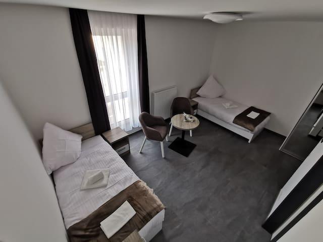 Studio Deluxe Twin Bedded Room HP Apartments