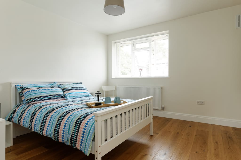 The larger bedroom has space enough to chill, work, exercise or just sleep!