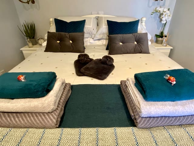King size bed with memory foam mattress and luxury bedding for a relaxing sleep under the thatch