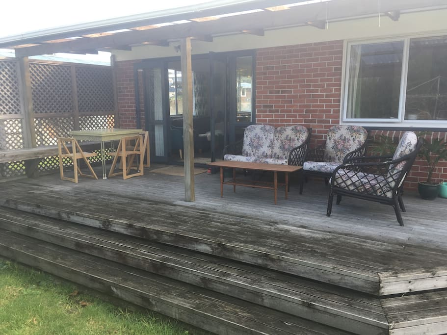 Private covered deck onto back lawn and vege garden
