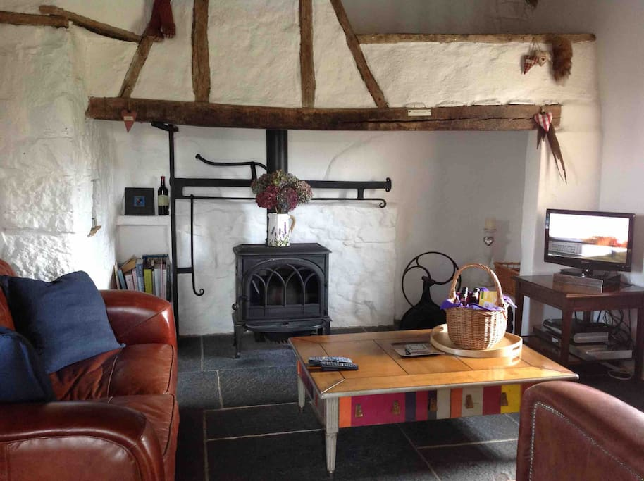 Comfy reception room with log burning stove, free wifi, cable tv