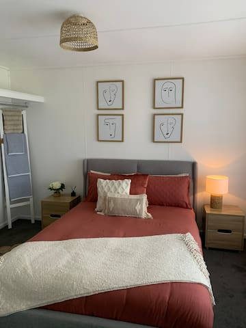 Bedroom 2 with queen bed and wardrobe facilities and luxurious linen.