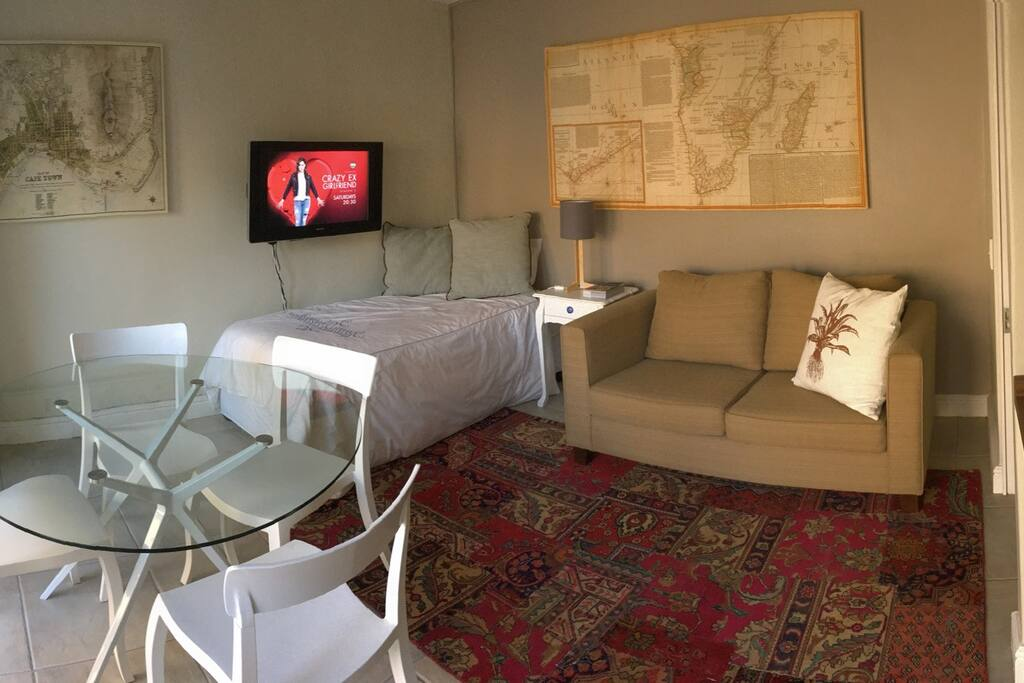 The lounge has a single bed and a second bathroom opens off this room.