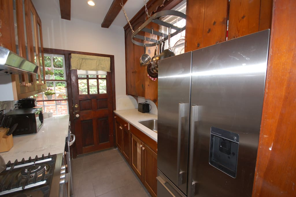 All new full kitchen with stainless steel appliances, including a washer/dryer combo