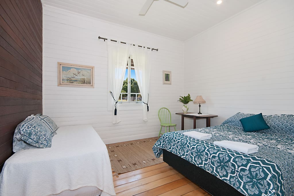 Room with Queen bed and single.