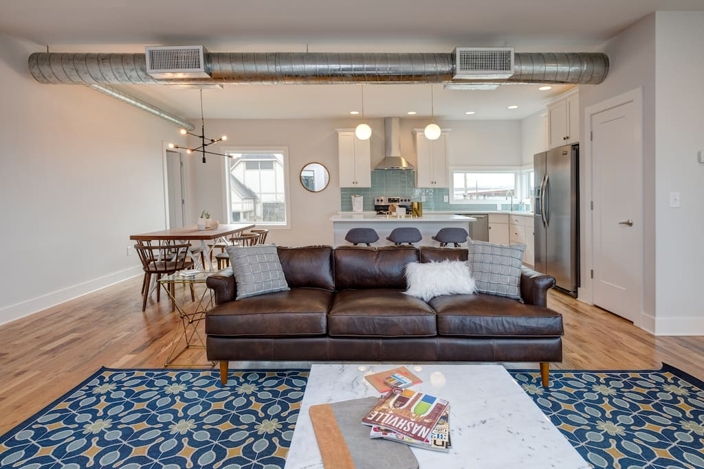 This stylish condo features a chic, industrial look with modern furnishings and decor.