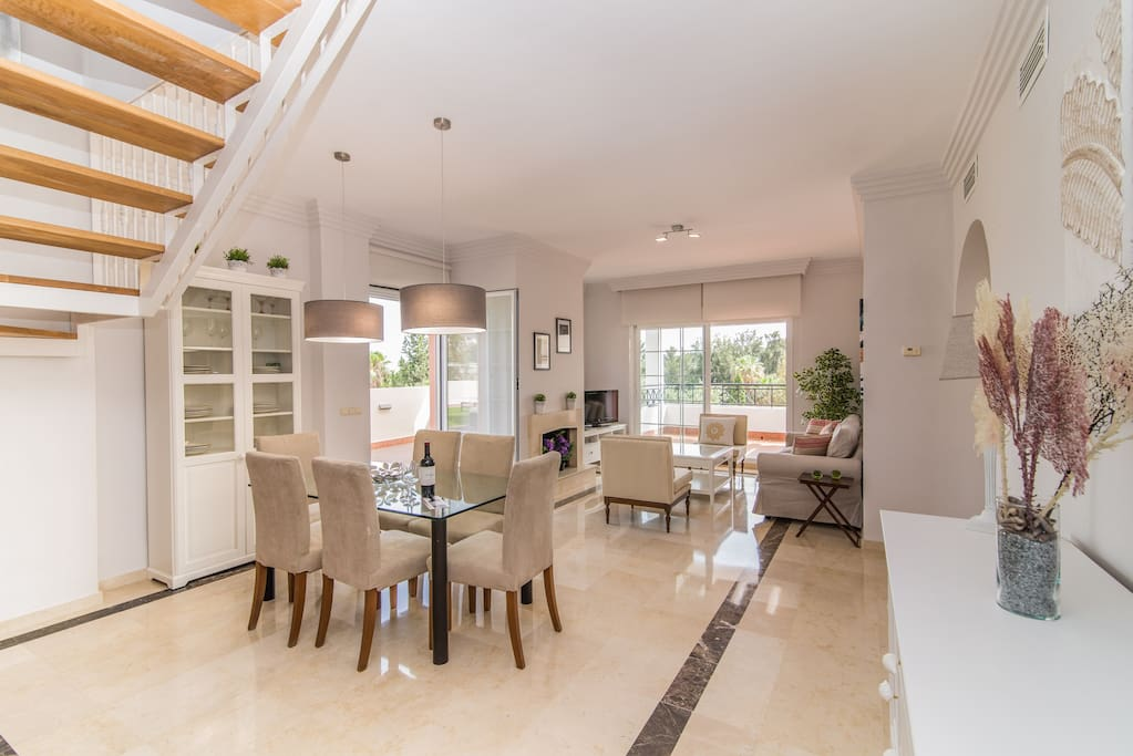 Lower floor - Spacious living room with comfy sofas, international TV and dining area