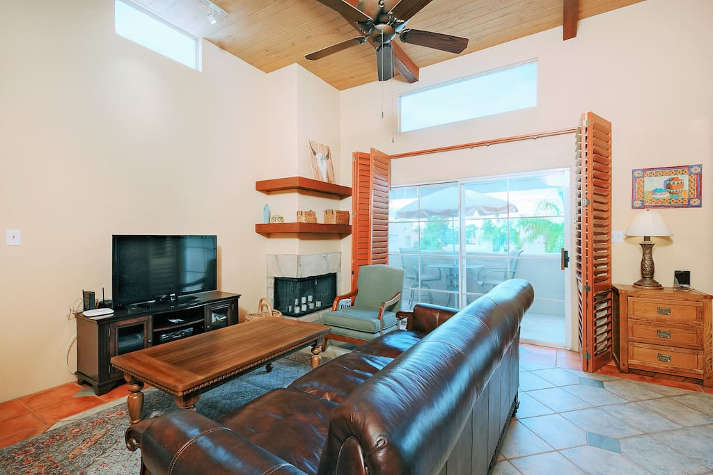"The stylish living room includes vaulted ceilings, tiled floors, a 46"" TV and the TurnKey HomeDroid Tablet. This electronic directory provides helpful information (e.g., TV instructions) and area activities."
