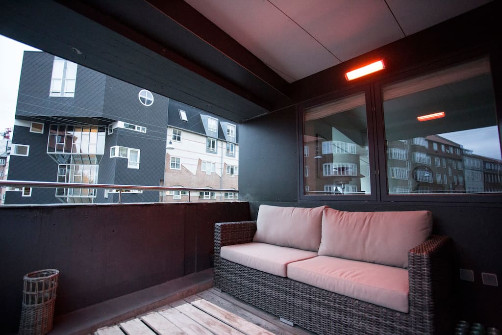 A balcony with heaters let you sit outside in most weather conditions.