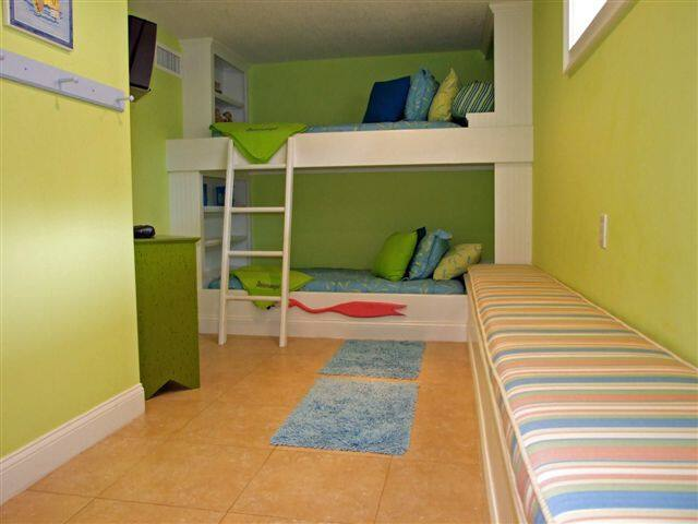 The Bunk Room is cozy with full size twin beds in a bunk style  complete with a smart tv
