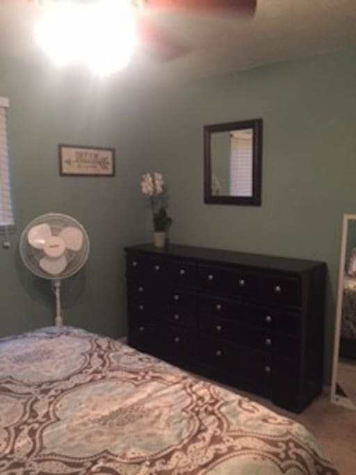 1 of 2 bedrooms. Showing stand fan and chest of drawers for your convenience. (Clearly fans are important. A nice breeze while sleeping is wonderful.)