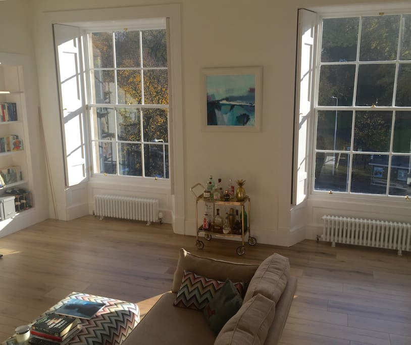 Huge windows letting lots of light and sunshine in